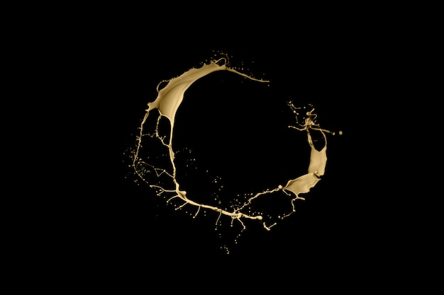 Golden paint splash isolated on black background.