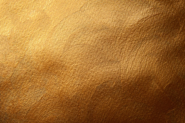 Golden painted texture background. decorative surface.