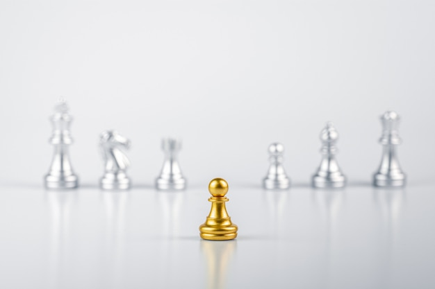 Golden pawn chess standing encounter enemies. - leadership concept.