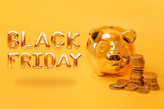 Golden piggy bank with money towers on yellow background with text black friday