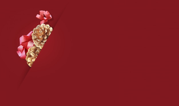 Golden pine cones on red background.merry christmas and  happy new year concept background with copy space.