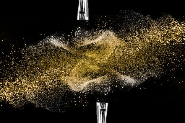 Golden powder black background