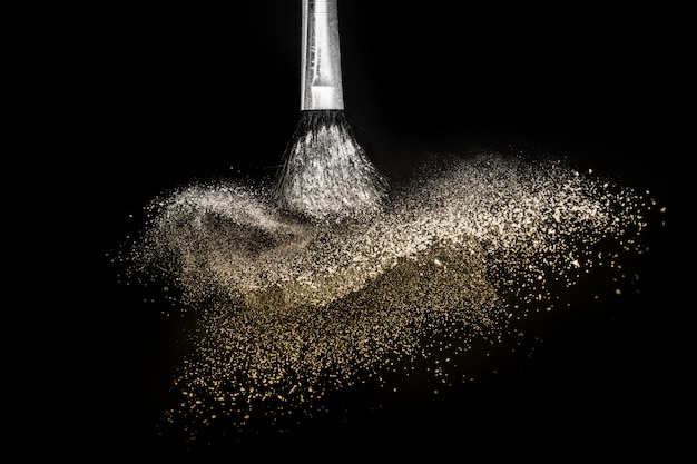 Golden powder splash and brush