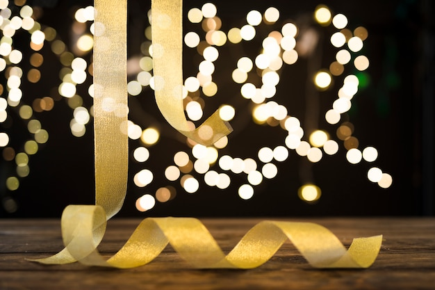 Golden ribbon hanging near abstract lights