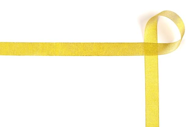 Golden ribbon isolated on white background.