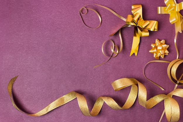 Golden ribbon on purple background