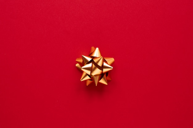 Golden ribbon on red background