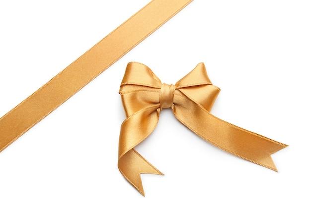 Золотая лента с бантом на белом