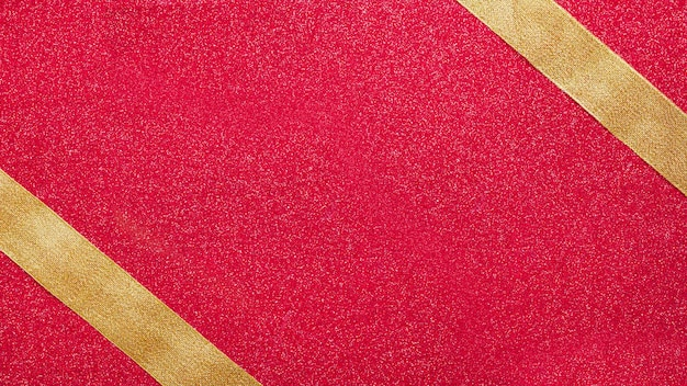 Golden ribbons in corners of red background