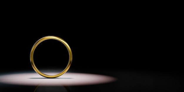 Golden ring frame spotlighted on black background