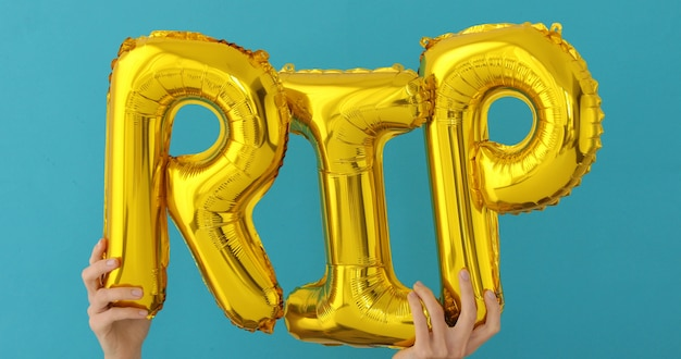 Golden rip words made of inflatable balloons