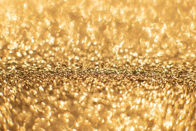 黄金の砂の抽象的なボケ味が点灯します。多重背景