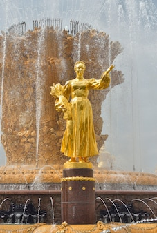 Golden sculpture on the fountain friendship of peoples in park