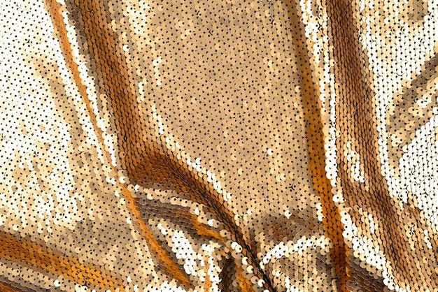 Golden sequins fabric texture.