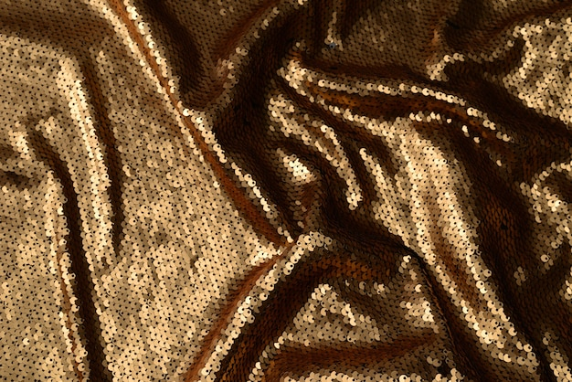 Golden sequins fabric texture