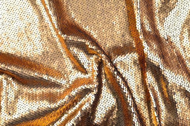 Текстура ткани золотые блестки.