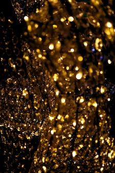 金色の光沢のある豪華なぼやけたガラスのきらめく背景あなたのデザインのためのお祝いのコンセプト