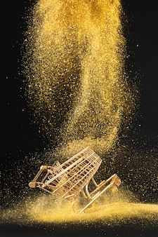 Golden shopping cart in golden glitter