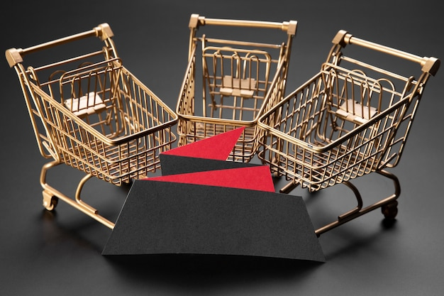 Golden shopping carts on black background