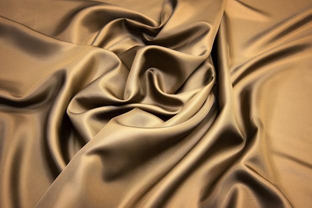 Золотая шелковая ткань