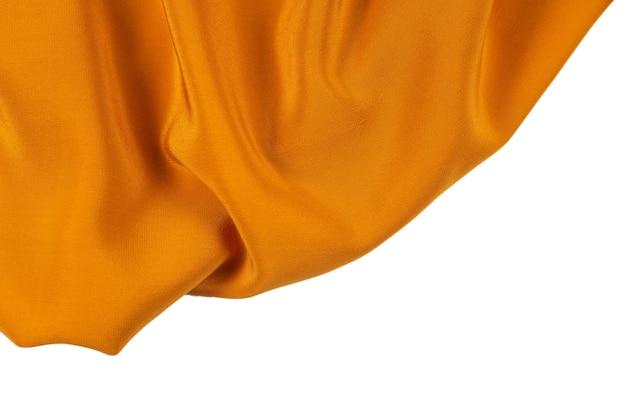 ゴールデンシルクまたはサテンの高級生地の質感は、抽象的な背景として使用できます。上面図。