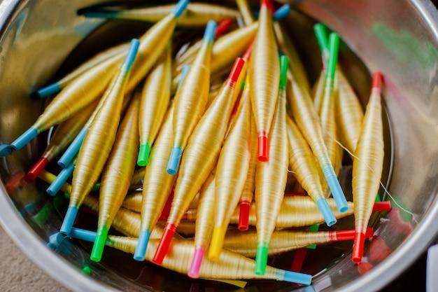 Golden silk thread in bucket