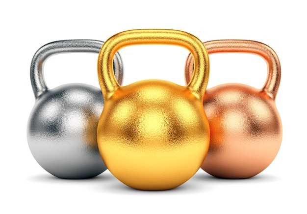 Golden, silver and bronze kettle bells isolated on white background.