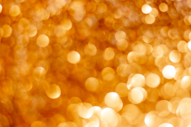 Golden silver glitter bokeh blurred abstract background overlay