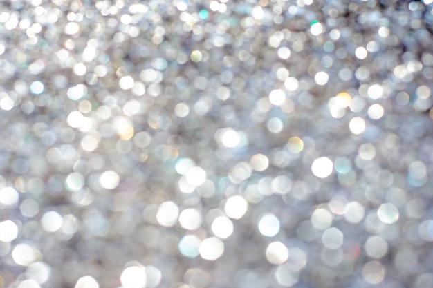 Golden silver glitter bokeh blurred abstract overlay