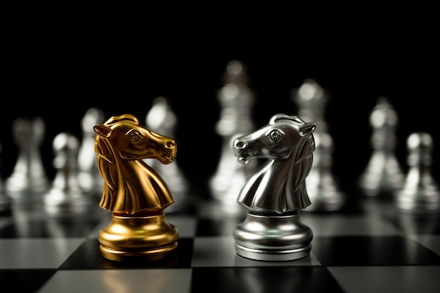 Golden and silver horse chess pieces