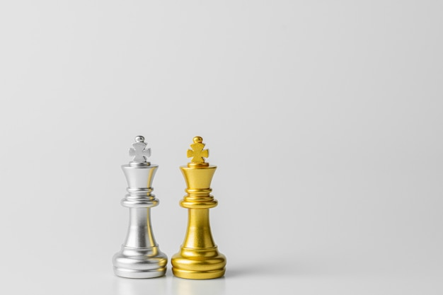 Golden and silver king chess standing encounter.