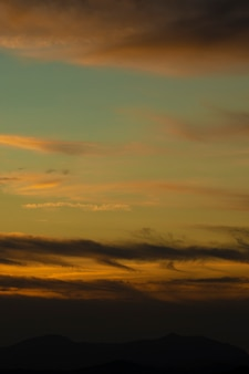 Golden sky with white cotton clouds