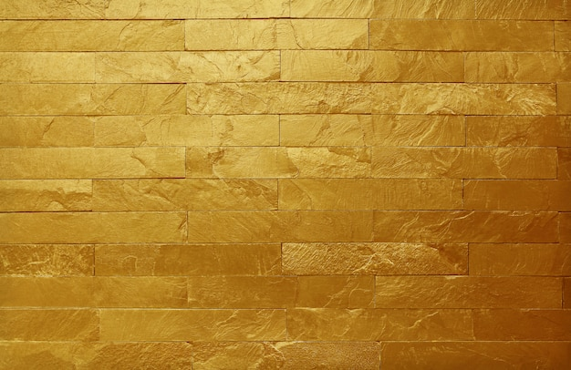 Golden slate stone wall texture in natural pattern with high resolution for background.