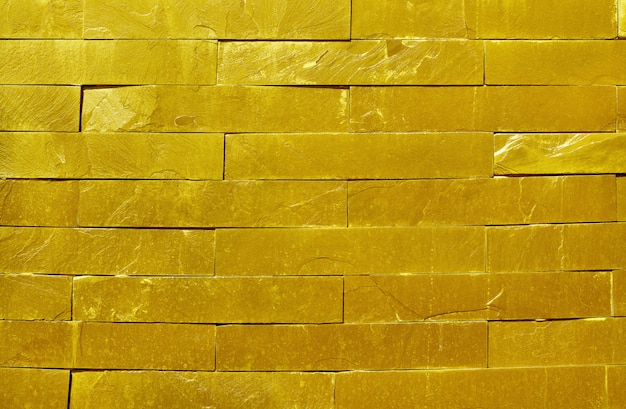 Golden slate stone wall texture in natural surface with high resolution for background