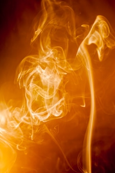 Golden smoke on black background