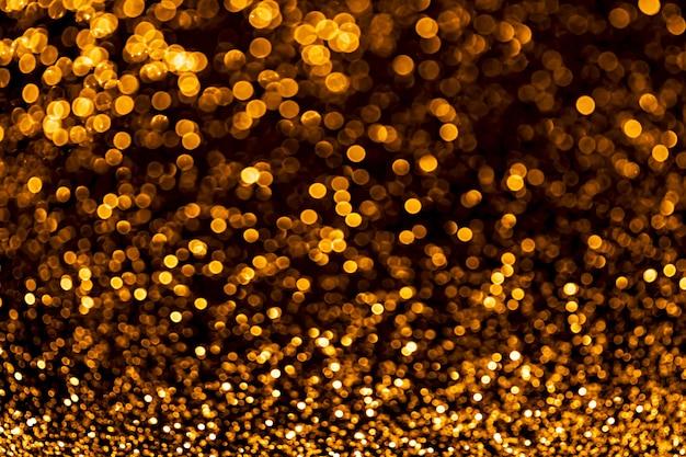 Золотые блестки растровый праздничный фон боке огни с ярким блестящим эффектом иллюстрации перекрывающиеся светящиеся и мерцающие пятна декоративный фон абстрактные сверкающие круги