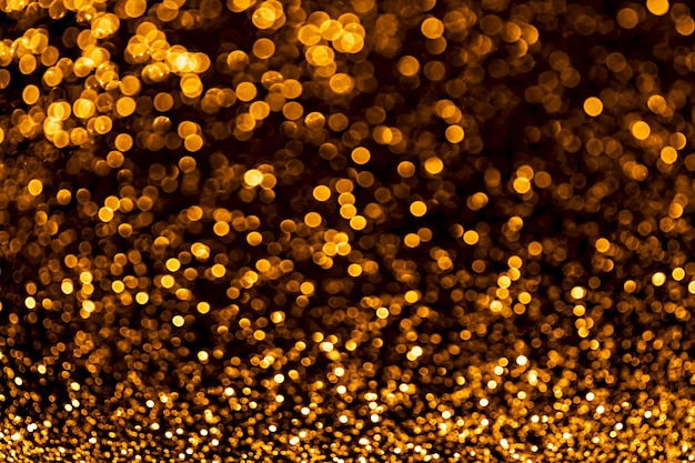 Golden sparkles raster festive background bokeh lights with bright shiny effect illustration overlapping glowing and twinkling spots decorative backdrop abstract glittering circles