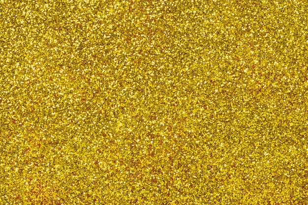 Golden sparkling background from small sequins