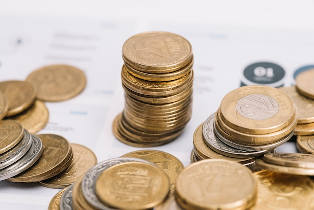Golden stack of coins over the infographic template