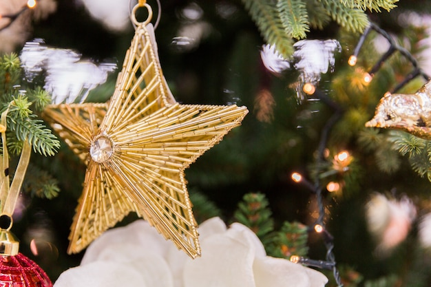 Golden star on christmas tree. new year decorations