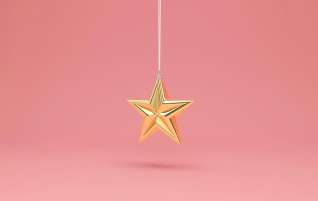 Golden star toy hanging on pink studio background