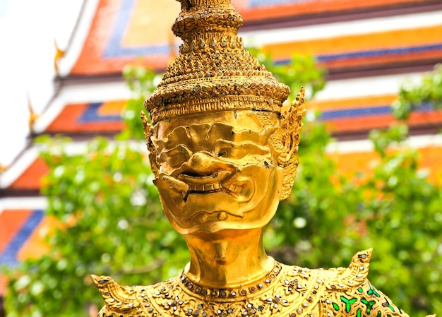 Golden statue in wat phra keao in the grand palace in bangkok thailand