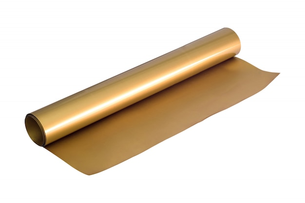 Golden sticker roll isolated on white background. foil sheet material.