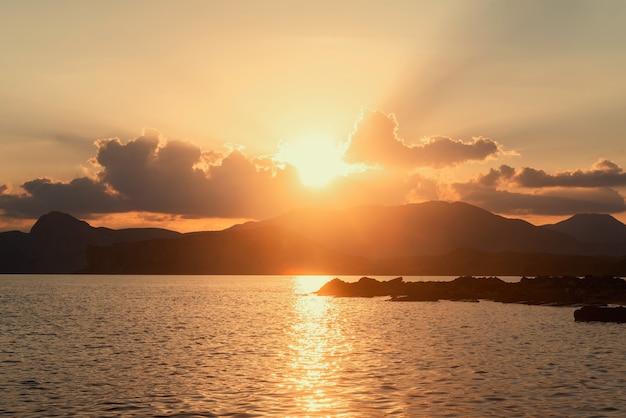 Golden sunset mountain sea coast