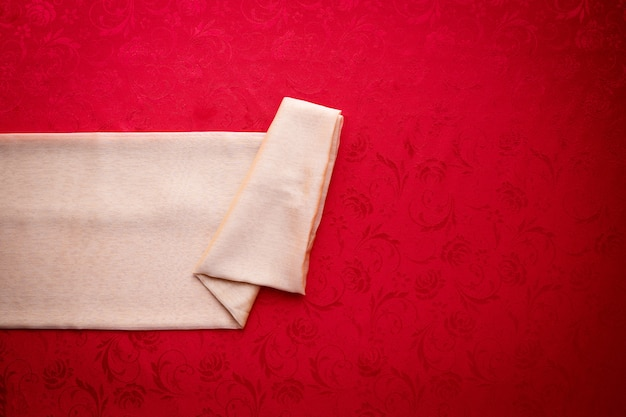 Golden tablecloth label on red background, concept of chinese new year background.
