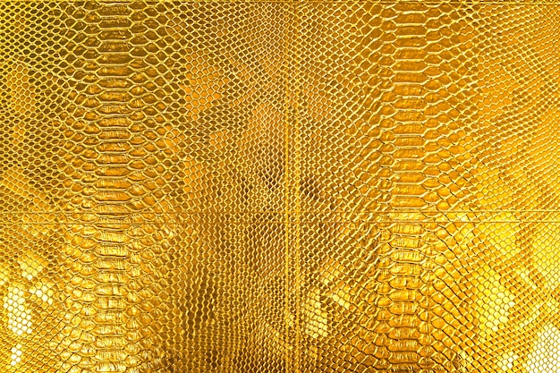 Золотая текстура змеиной чешуи Premium Фотографии