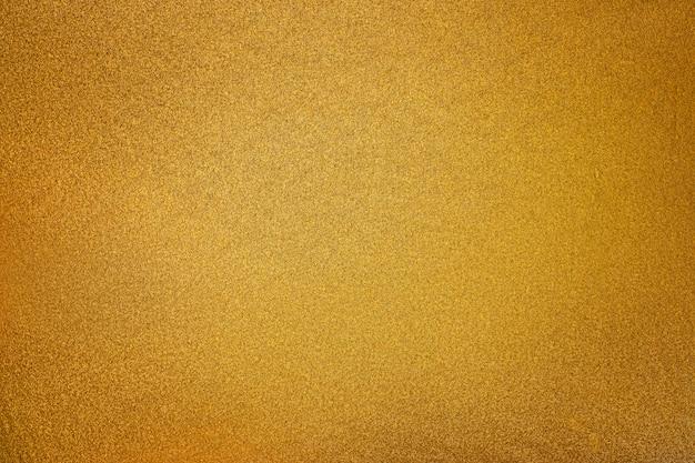ライトスポットの背景を持つ黄金のテクスチャ