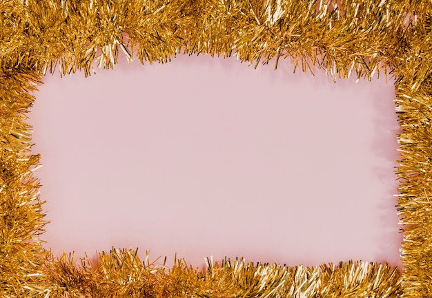 Golden tinsel frame with pink background