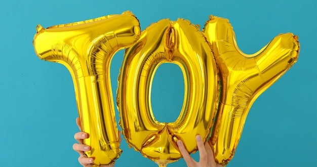 Golden toy words made of inflatable balloons