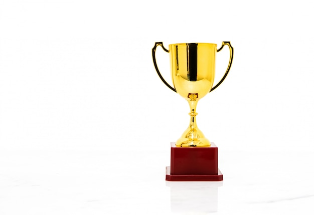 Golden trophy cup isolated on white background.